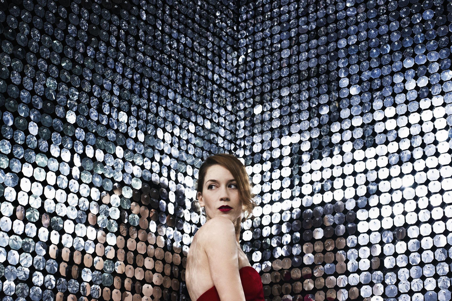 woman-poses-in-the-corner-of-a-room-of-mirrors.jpg